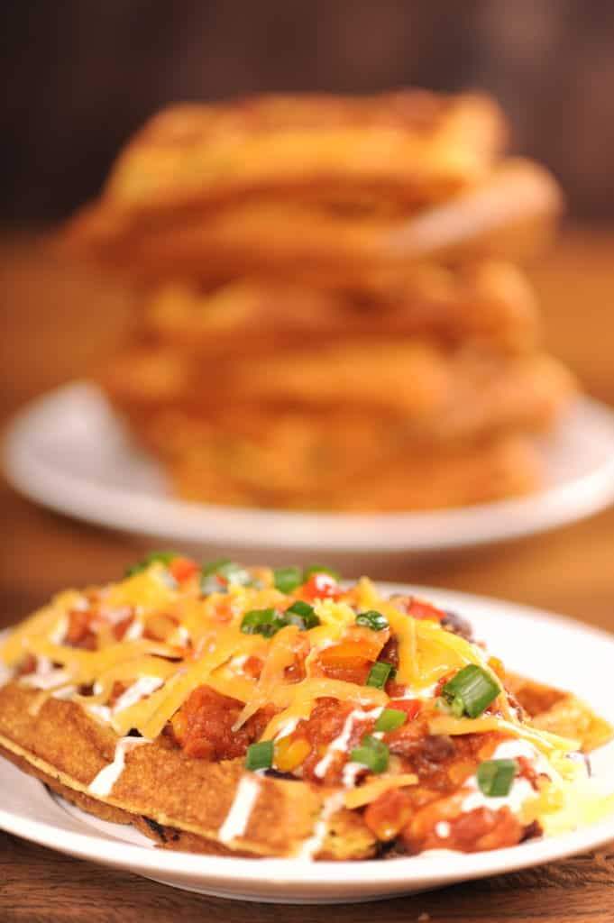 Chili and Cheese Piled on Crispy Jalapeno Cornbread Waffles