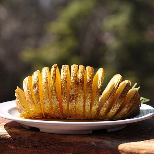 Hasselback Potato Recipe with Guajillo Chile Oil and Chipotle Sour Cream