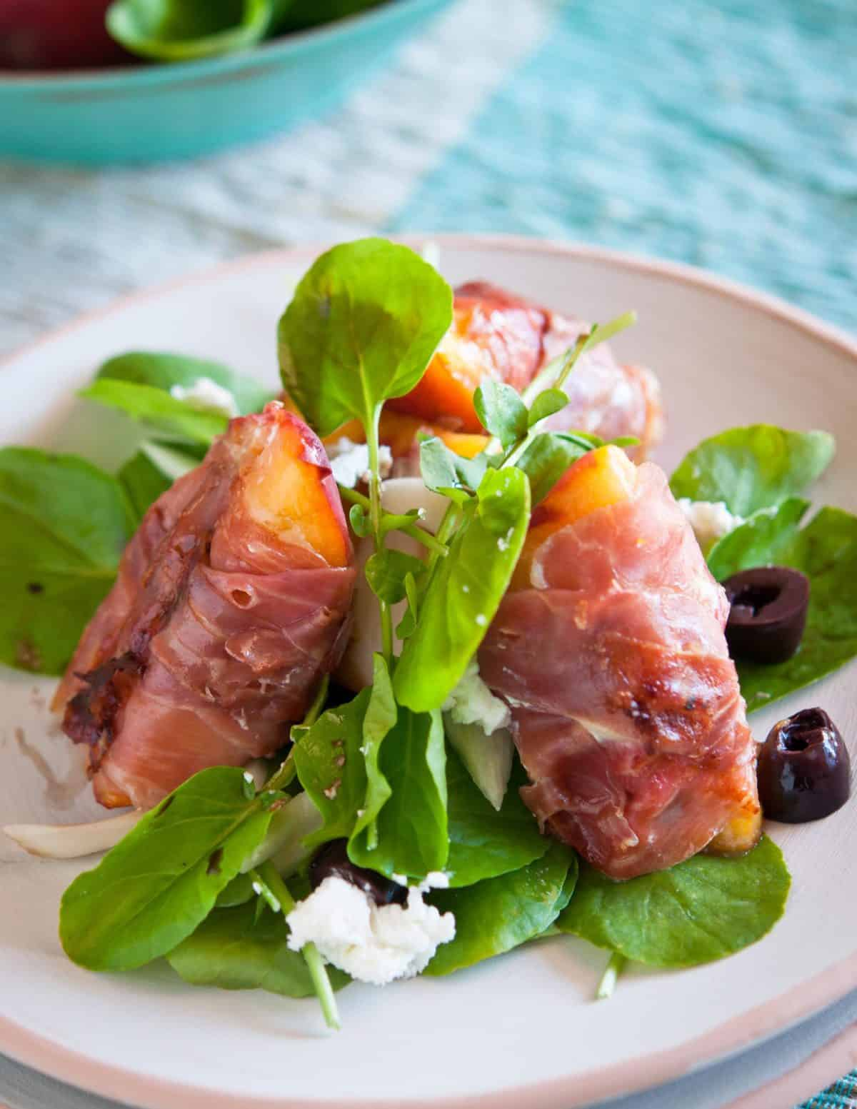 image Grilled Peach Salad with Prosciutto and Goat Cheese