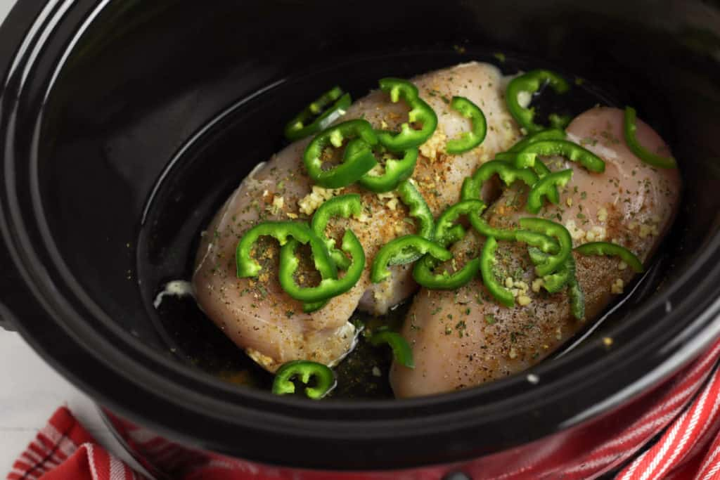 Cook chicken breasts in the slow cooker with jalapeños, lime and Southwest seasonings.